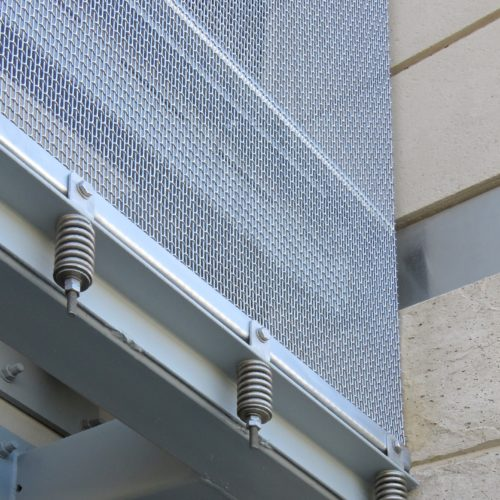 "Photography of project ""What is a wire mesh façade? (Benefits, Cost, What's Included)"""